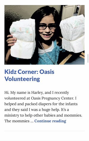 Picture of Harley Isabel Smith Holding Diaper Bundles for October 2019 Oasis Article for Dunndeal Publications
