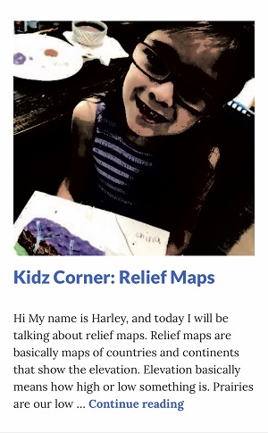 Picture of Harley Isabel Smith Holding Relief Map of Nepal for Dec 2019 Relief Map Article for Dunndeal Publications
