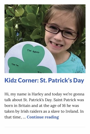 Picture of Harley Isabel Smith Holding Shamrock Craft for March 2020 St Patricks Day Article for Dunndeal Publications