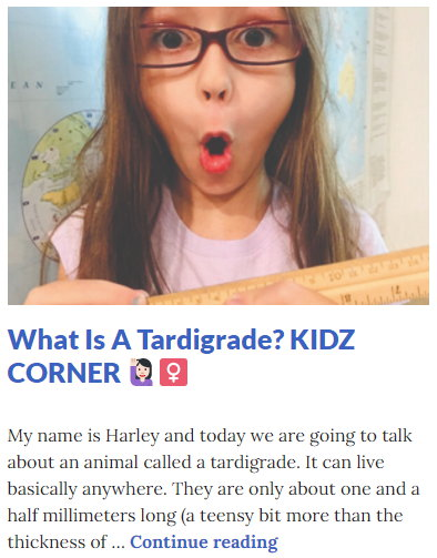 Picture of Harley Isabel Smith Holding Ruler for February 2021 Tardigrade Article for Dunndeal Publications